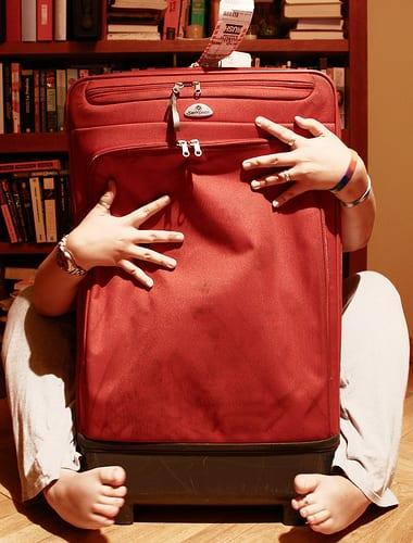 Female holding suitcase