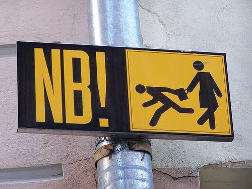 Street sign warning of theft