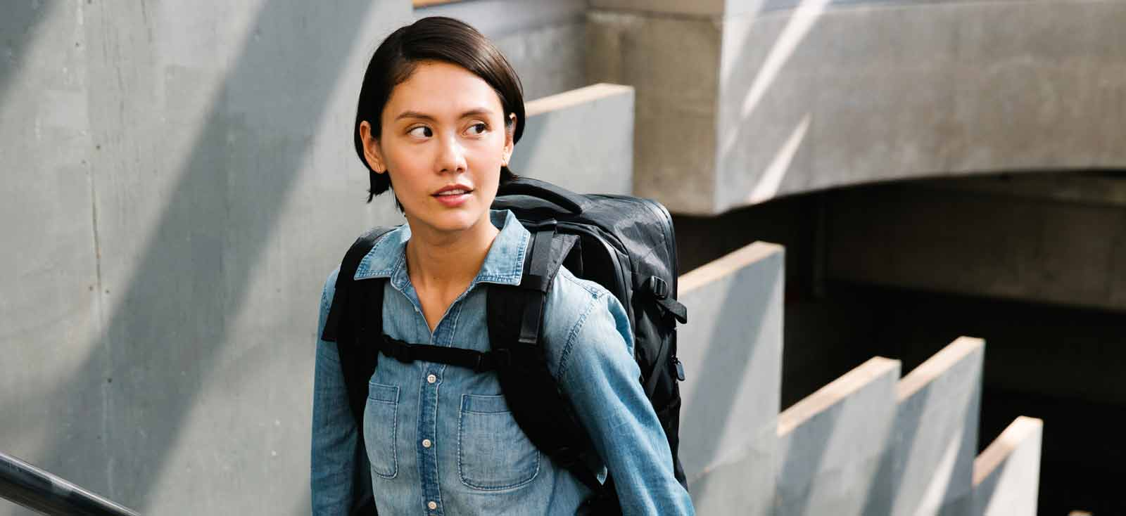 Woman Wearing Backpack in City