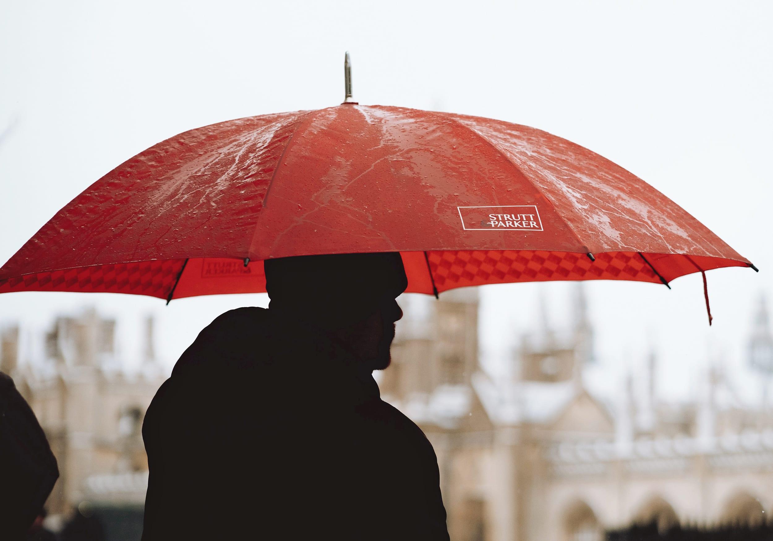 a man under a red umbrella