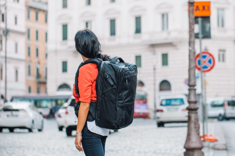 Woman wearing backpack with hip belt in city