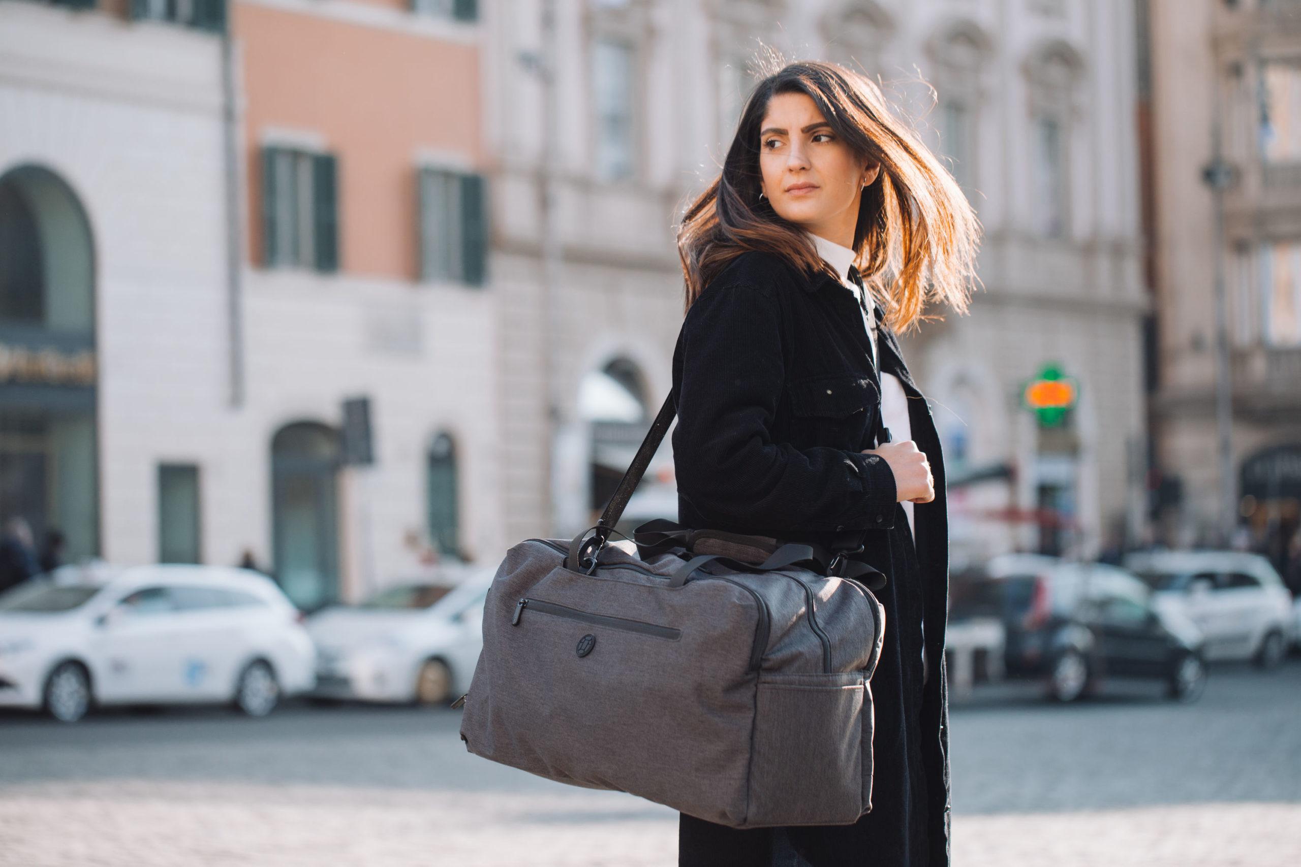 Woman carrying duffle bag in Rome