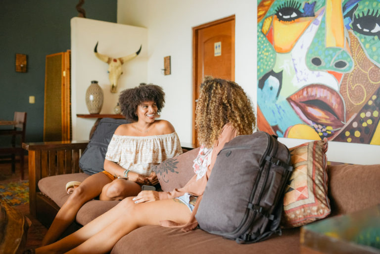 Women sitting on a couch in an Airbnb