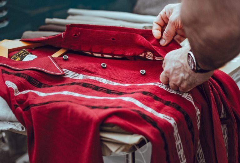 Buttoning up a red shirt