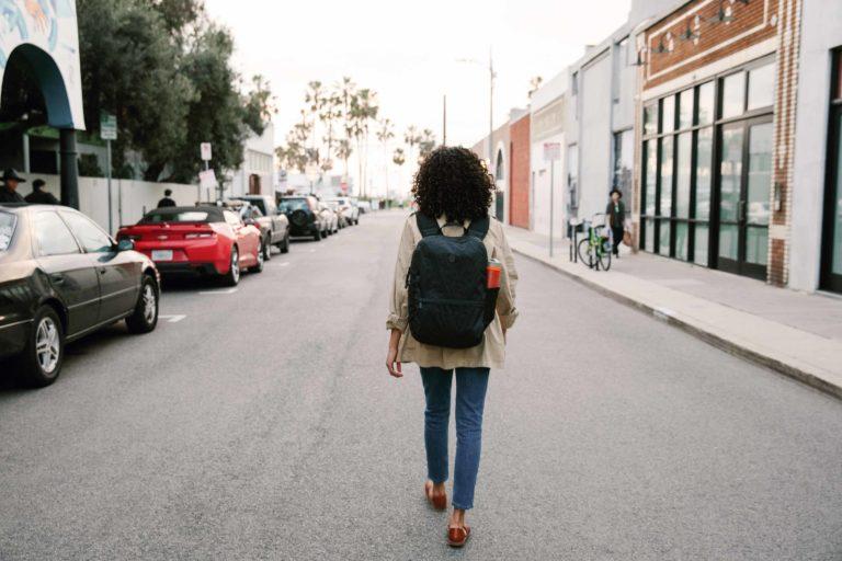 minimalist traveler walking down the street