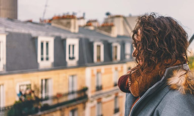 a woman looks over the streets of Paris