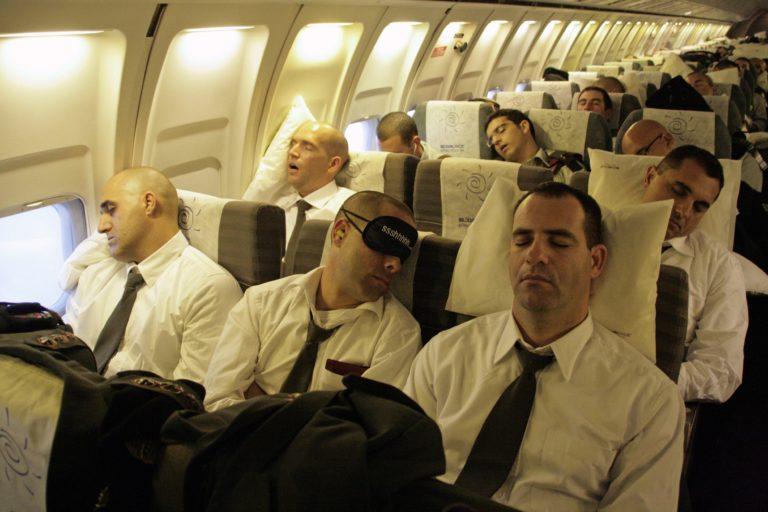 Passengers sleeping on a long haul flight