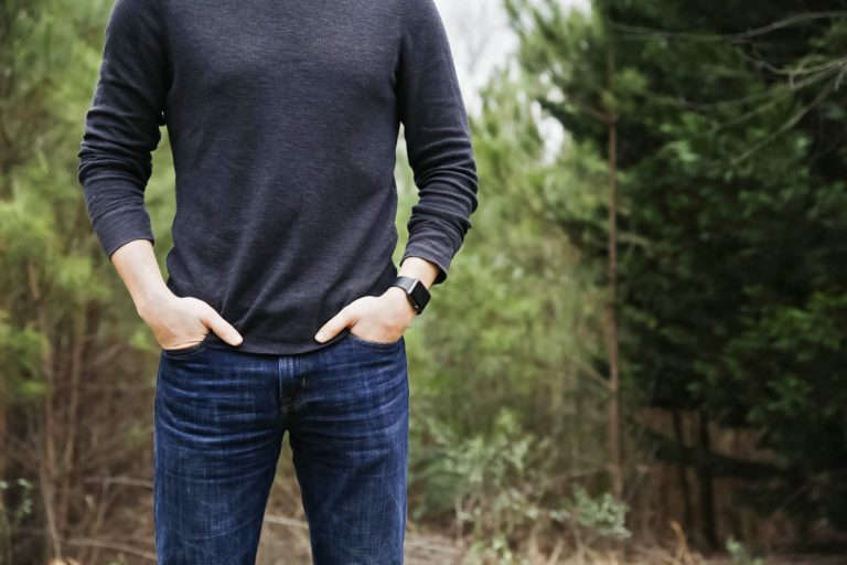 Man wearing sweater with hands in his pockets