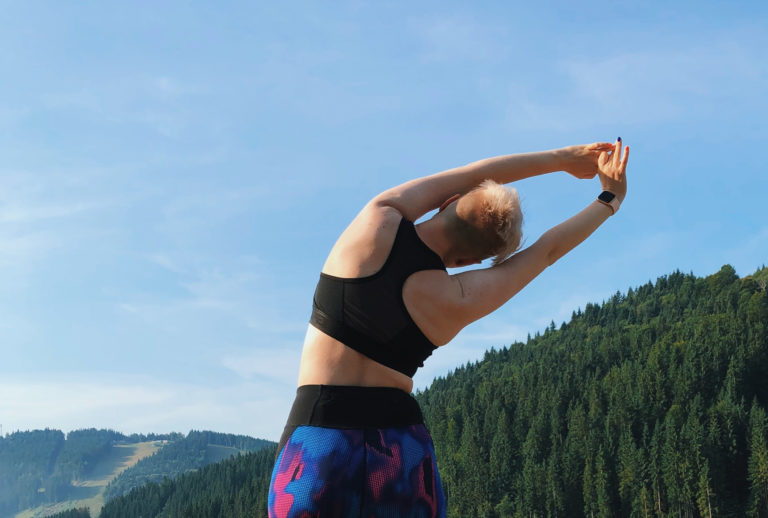 Stretching in a travel sports bra