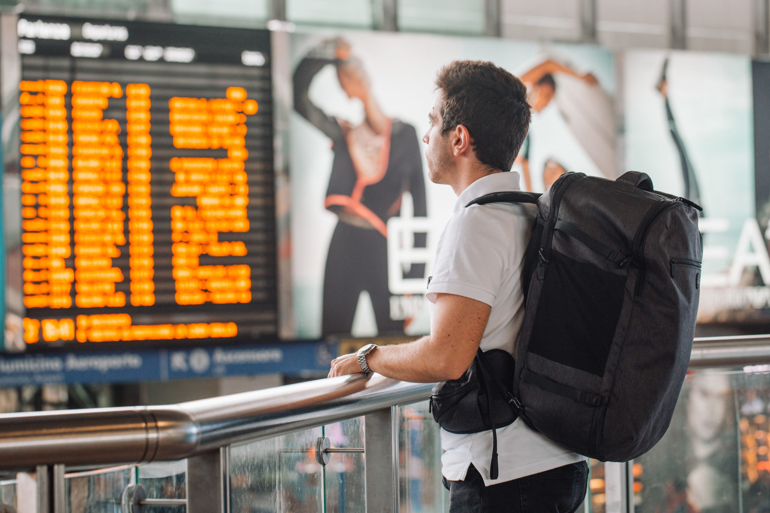 Man checking departures board at the airport